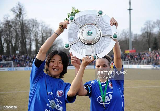 Yuki Nagasato and Isabel Kerschowski celebrate with the trophy after winning the Women Bundesliga match between Turbine Potsdam and EssenSchoenebeck...