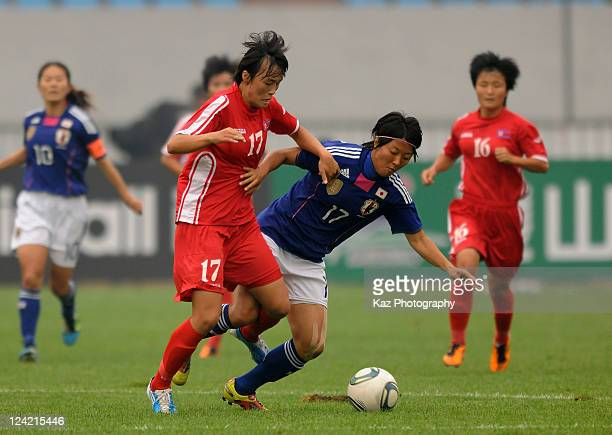 Yuki Nagasato of Japan and Jon Myong Hwa of North Korea compete for the ball during the London Olympic Women's Football Asian Qualifier match between...