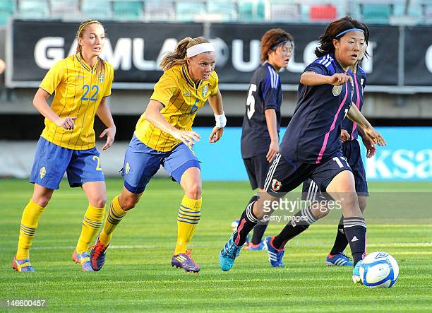 Yuki Nagasato of Japan is pursued by Sara Thunebro and Kosovare Asllani of Sweden during the Women's Volvo Winners Cup match between Sweden and Japan...