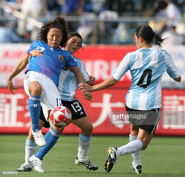 Yuki Nagasato of Japan keeps the ball against Maria Florencia Quinones of Argentina during the women's international friendly soccer match between...