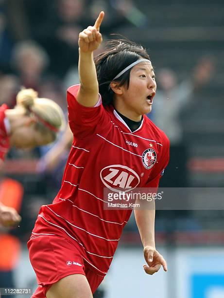 Yuki Nagasato of Potsdam celebrates after scoring the first goal during the UEFA Women's Champions League semifinal second leg match between Turbine...