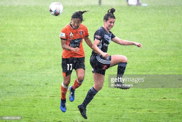 Yuki Nagasato of the Roar and Bethany MasonJones of the Victory challenge for the ball during the round seven WLeague match between the Brisbane Roar...
