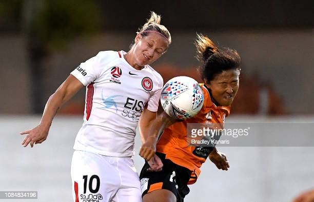 Yuki Nagasato of the Roar and Kylie Ledbrook of the Wanderers challenge for the ball during the round eight WLeague match between the Brisbane Roar...