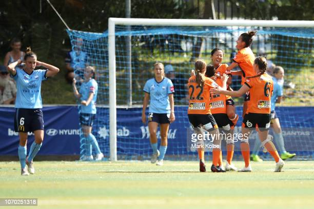 Yuki Nagasato of the Roar celebrates with her team mates after scoring a goal during the round six WLeague match between Sydney FC and the Brisbane...