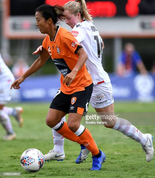 Yuki Nagasato of the Roar is and Dylan Holmes of Adelaide challenge for the ball during the WLeague match between the Brisbane Roar and Adelaide...