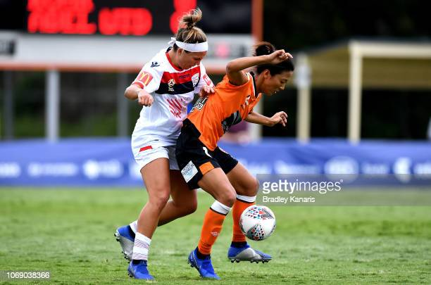 Yuki Nagasato of the Roar is challenged by the defence during the WLeague match between the Brisbane Roar and Adelaide United at the Lions Club on...