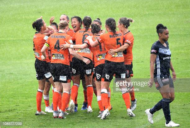 Yuki Nagasato of the Roar is congratulated by team mates after scoring a goal during the round seven WLeague match between the Brisbane Roar and the...