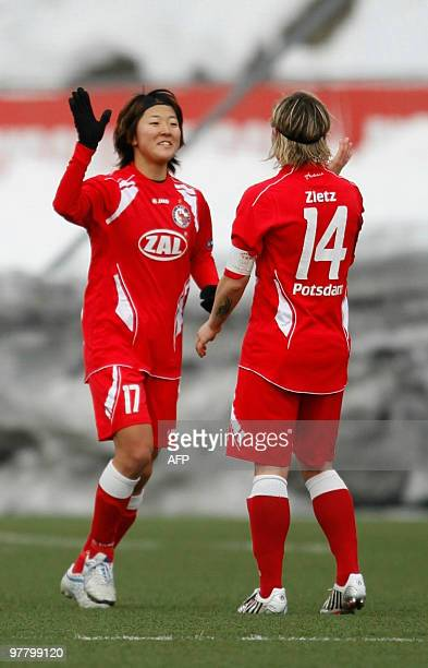 Yuki Nagasato of Turbine Potsdam celebrates her 40 goal with Jennifer Zietz during the Champions League match against Roa of Norway at Roa in Oslo on...