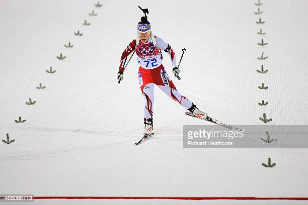 Yuki Nakajima of Japan cross the finish line in the Women's 75 km Sprint during day two of the Sochi 2014 Winter Olympics at Laura Crosscountry Ski...