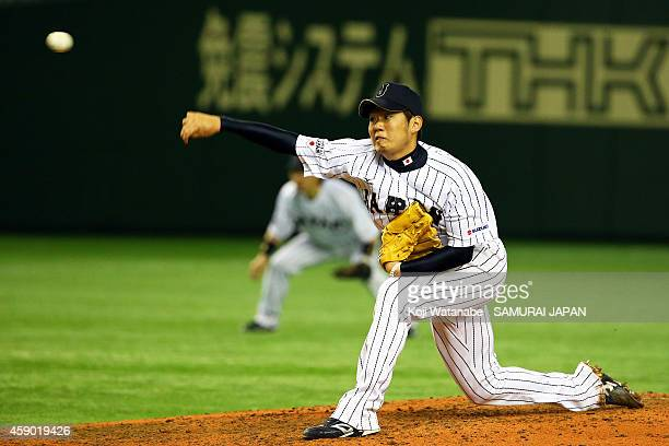 Yuki Nishi of Samurai Japan pitches in the sixth inning during the game three of Samurai Japan and MLB All Stars at Tokyo Dome on November 15 2014 in...
