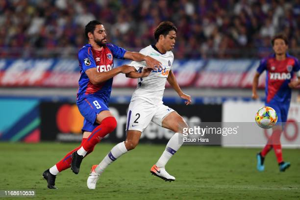 Yuki Nogami of Sanfrecce Hiroshima and Diego Oliveira of FC Tokyo compete for the ball during the J.League J1 match between FC Tokyo and Sanfrecce...