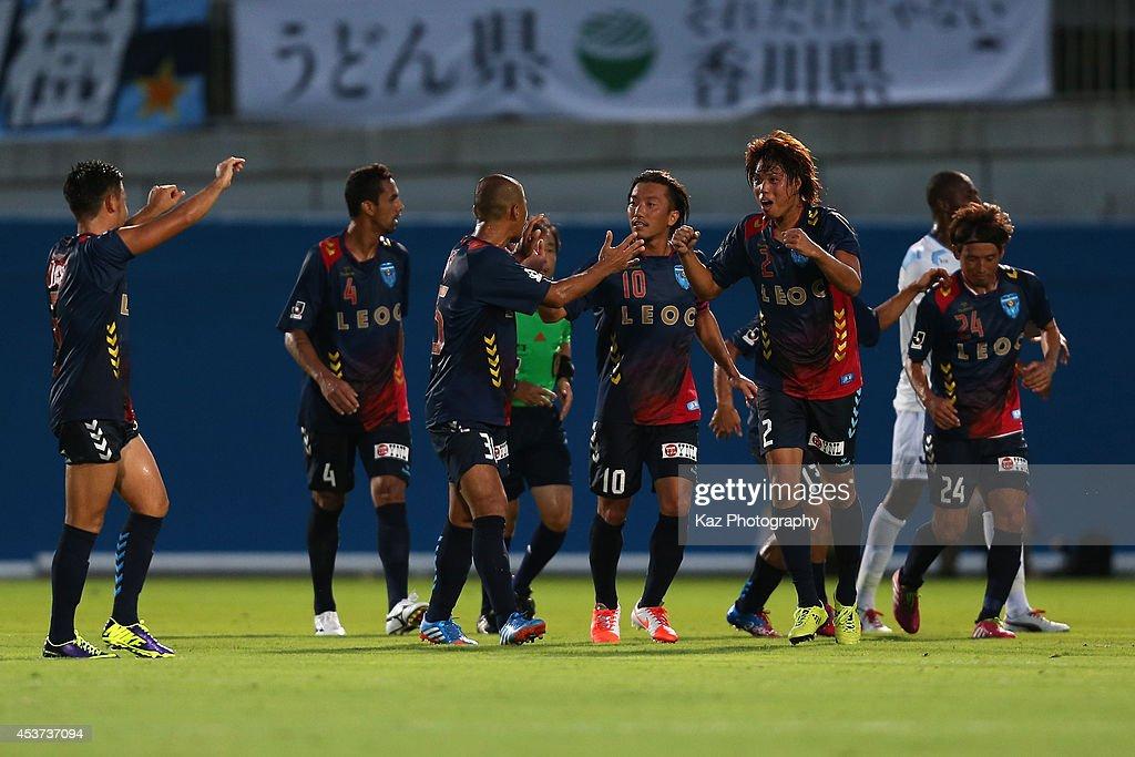 Yuki Nogami (2nd R) of Yokohama FC celebrates scoring his team's second goal with his teammates during the J. League 2 match between Yokohama F.C. and Kamatamare Sanuki at the Nippatsu Mitsuzawa Stadium on August 17, 2014 in Yokohama, Japan.
