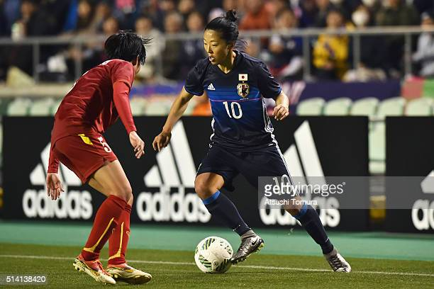 Yuki Ogimi of Japan and Bui Thi Nhu of Vietnam compete for the ball during the AFC Women's Olympic Final Qualification Round match between Vietnam...