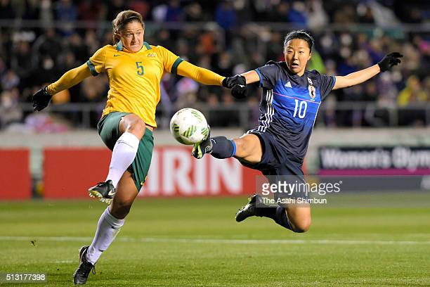 Yuki Ogimi of Japan and Laura Alleway of Australia compete for the ball during the AFC Women's Olympic Final Qualification Round match between...