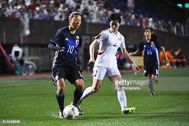 Yuki Ogimi of Japan and Ri Hui Jong of North Korea compete for the ball during the AFC Women's Olympic Final Qualification Round match between Japan...