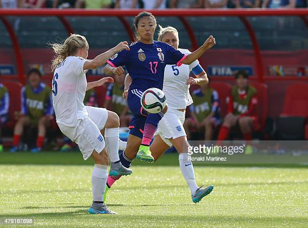 Yuki Ogimi of Japan battles Katie Chapman and Steph Houghton of England during the FIFA Women's World Cup Semi Final match between Japan and England...
