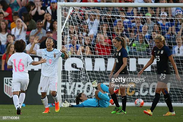 Yuki Ogimi of Japan celebrates her goal against Hope Solo of United States of America with Mizuho Sakaguchi of Japan as Morgan Brian and Allie Long...