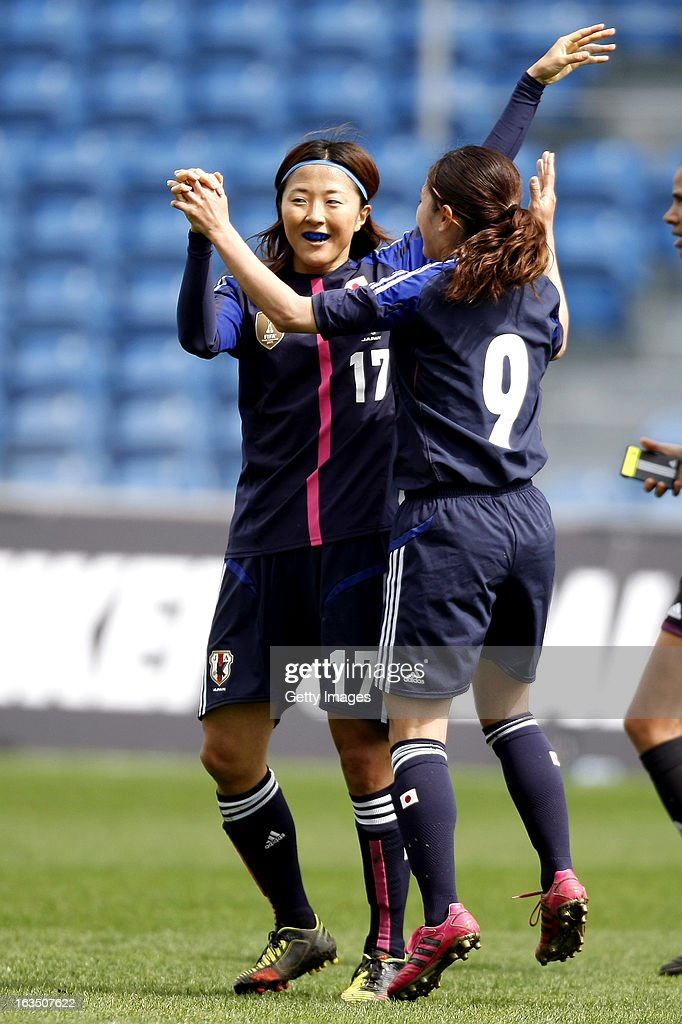 Yuki Ogimi of Japan celebrates her goal (0-2) with Nahomi Kawasumi of Japan during the Algarve Cup 2013 match between Denmark and Japan at the Algarve stadium on March 11, 2013 in Faro, Portugal.
