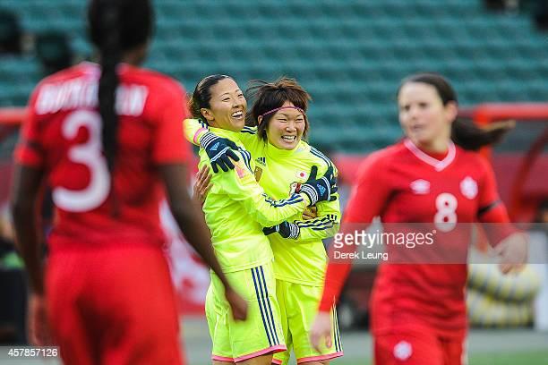 Yuki Ogimi of Japan celebrates scoring her team's first goal with her teammate Mizuho Sakaguchi during a match at Commonwealth Stadium on October 25...