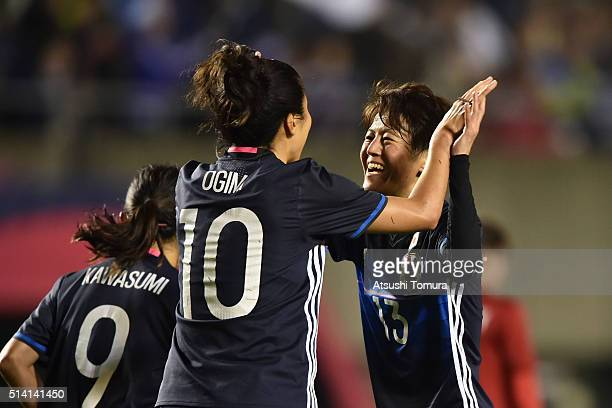 Yuki Ogimi of Japan celebrates scoring her team's sixth goal with her team mate Saori Ariyoshi during with her team mate the AFC Women's Olympic...