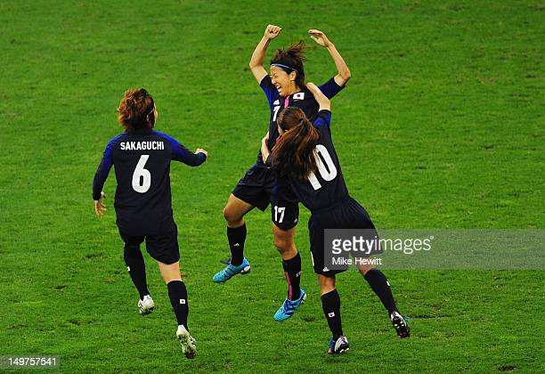 Yuki Ogimi of Japan celebrates with team mates Mizuho Sakaguchi and Homare Sawa of Japan after scoring the opening goal during the Women's Football...