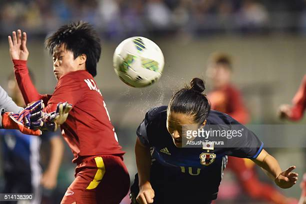 Yuki Ogimi of Japan heads the ball during the AFC Women's Olympic Final Qualification Round match between Vietnam and Japan at Kincho Stadium on...