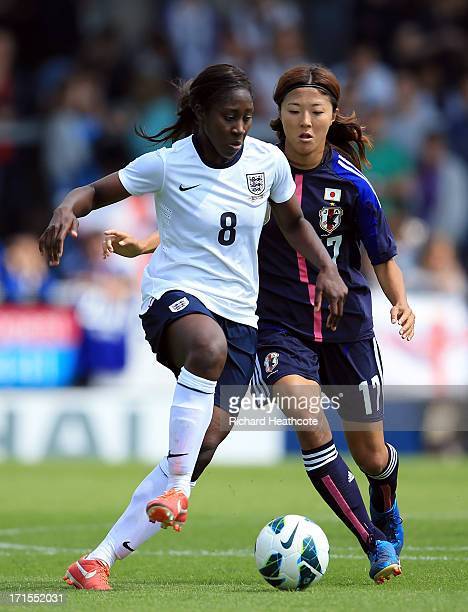 Yuki Ogimi of Japan holds off Anita Asante of England during the Women's International match between England and Japan at the Pirelli Stadium on June...