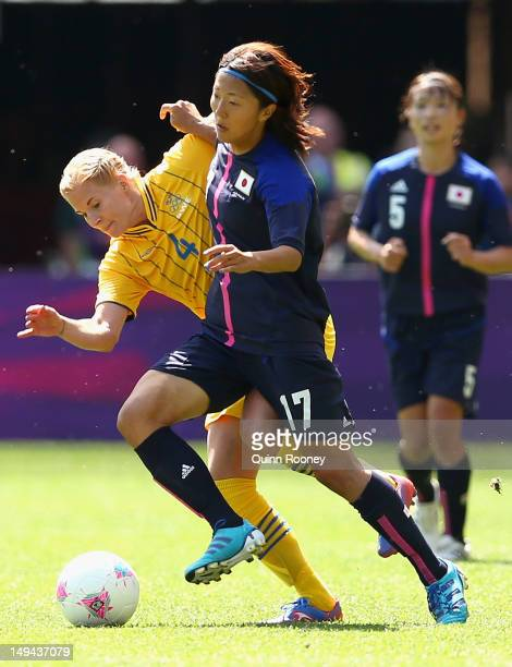Yuki Ogimi of Japan is tackled by Annica Svensson of Sweden during the Women's Football first round Group F Match of the London 2012 Olympic Games...