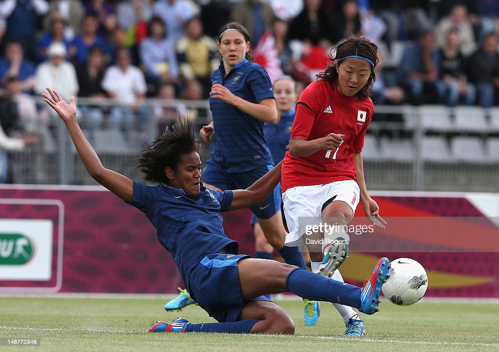 Yuki Ogimi of Japan is tackled by Wendie Renard during the friendly international match between Japan Women and France Women at Stade Charlety on July 19, 2012 in Paris, France.