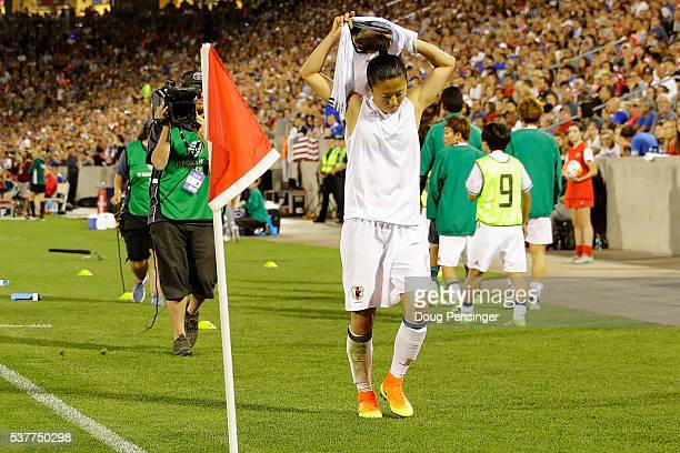 Yuki Ogimi of Japan leaves the pitch after receiving her second yellow card of the game for fouling Julie Johnston of United States of America and is...