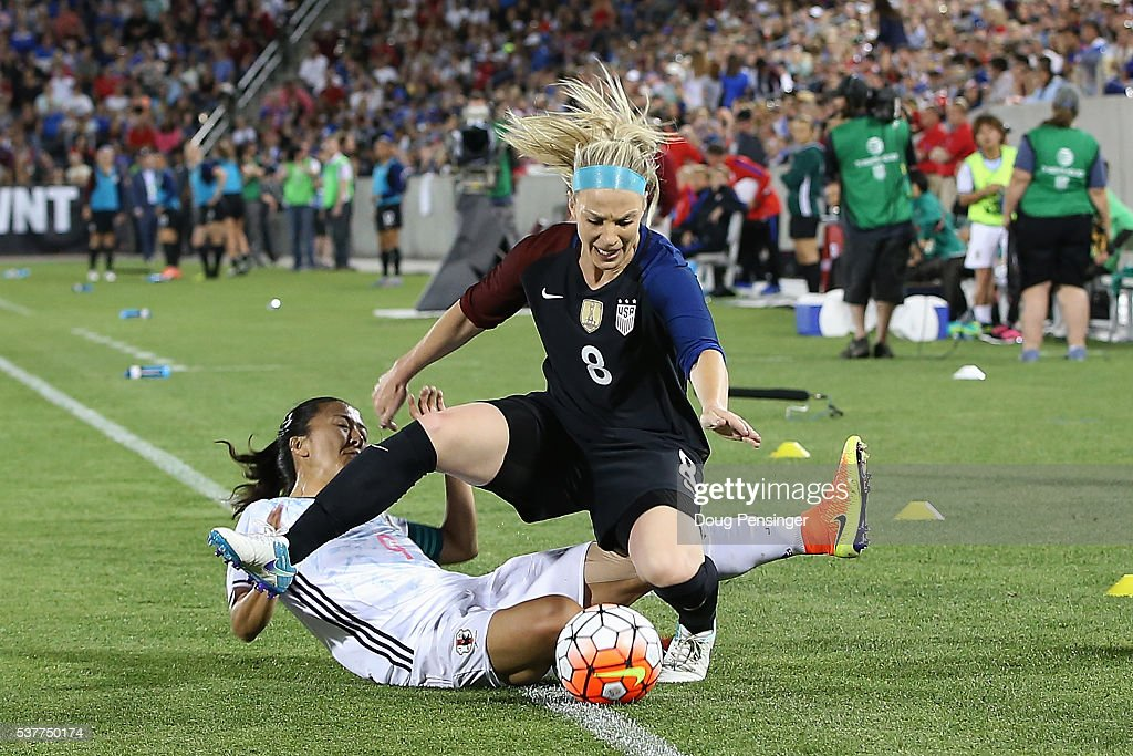 Yuki Ogimi #9 of Japan receives her second yellow card of the game for fouling Julie Johnston #8 of United States of America and is ejected in the 57th minute during an international friendly match at Dick's Sporting Goods Park on June 2, 2016 in Commerce City, Colorado. Japan and the United States played to a 3-3 draw.