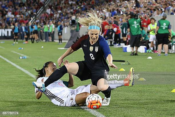 Yuki Ogimi of Japan receives her second yellow card of the game for fouling Julie Johnston of United States of America and is ejected in the 57th...