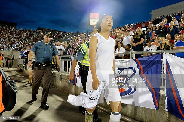 Yuki Ogimi of Japan walks off the pitch after being red carded against the US Women's National Team during the second half of their 33 tie The US...