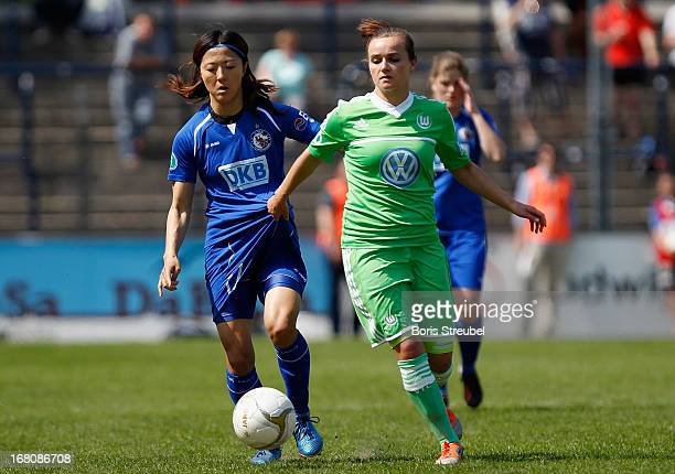 Yuki Ogimi of Potsdam and Lina Magull of Wolfsburg compete for the ball during the Women's Bundesliga match between 1 FFC Turbine Potsdam and VfL...
