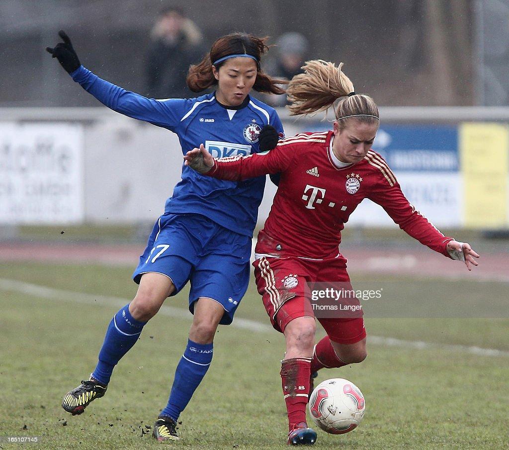 Yuki Ogimi of Potsdam challenges Clara Schoene of Munich (R) during the Women's Soccer Bundesliga Match between Bayern Muenchen and 1. FFC Turbine Potsdam on March 30, 2012 in Aschheim, Germany.