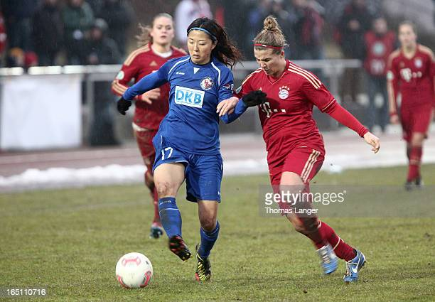 Yuki Ogimi of Potsdam runs with the ball during the Women's Soccer Bundesliga Match between Bayern Muenchen and 1 FFC Turbine Potsdam on March 30...