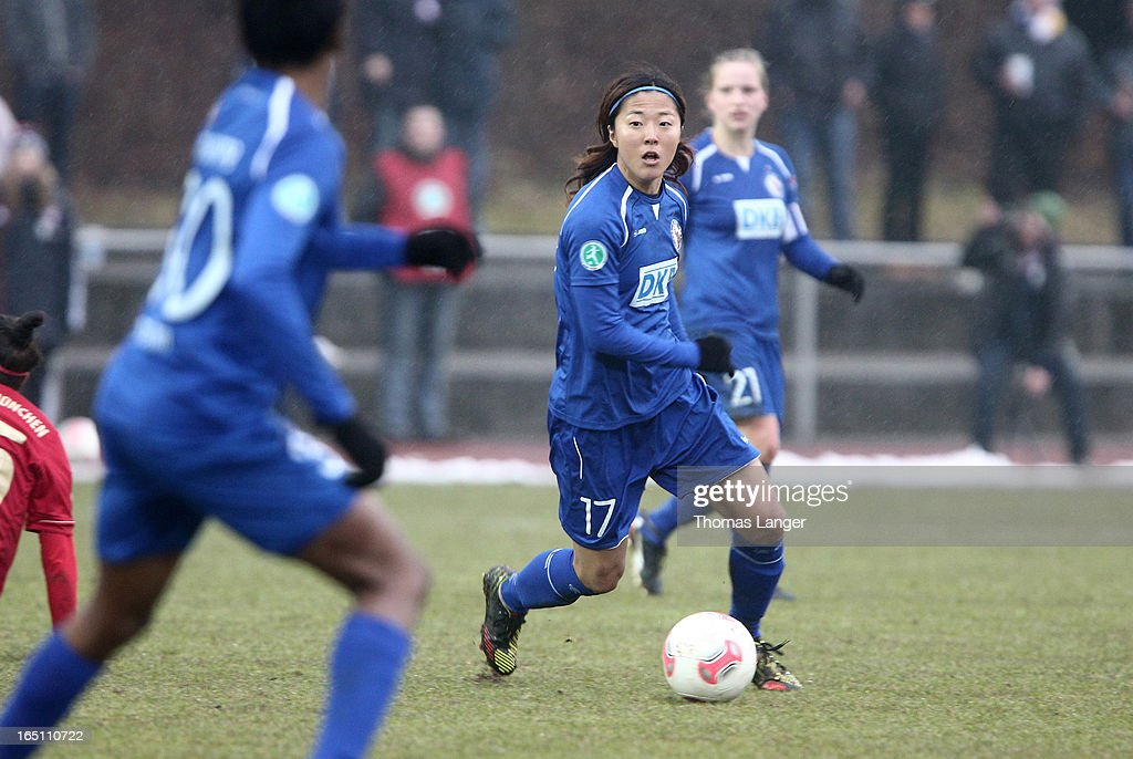 Yuki Ogimi of Potsdam runs with the ball during the Women's Soccer Bundesliga Match between Bayern Muenchen and 1. FFC Turbine Potsdam on March 30, 2012 in Aschheim, Germany.