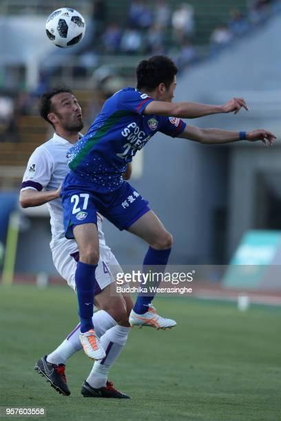 Yuki Omoto of Tokushima Vortis and Maracus Tulio Tanaka of Kyoto Sanga compete for the ball during the JLeague J2 match between Tokushima Vortis and...