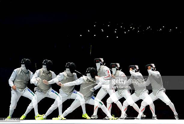 Yuki Ota of Japan competes against Andrea Cassara of Italy in the gold medal match of the Men's Foil Team Fencing finals on Day 9 of the London 2012...