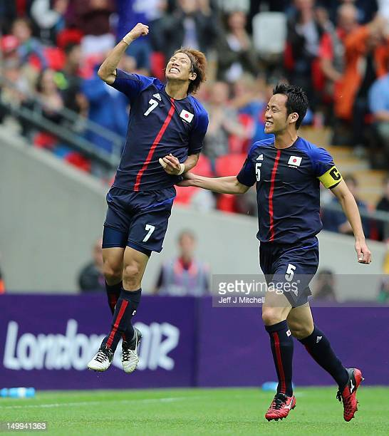 Yuki Otsu of Japan celebrates with Maya Yoshida during the Men's Football Semi Final match between Mexico and Japan on Day 11 of the London 2012...