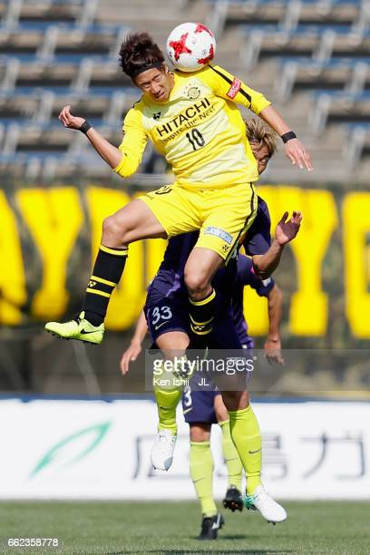 Yuki Otsu of Kashiwa Reysol and Tsukasa Shiotani of Sanfrecce Hiroshima compete for the ball during the JLeague J1 match between Sanfrecce Hiroshima...