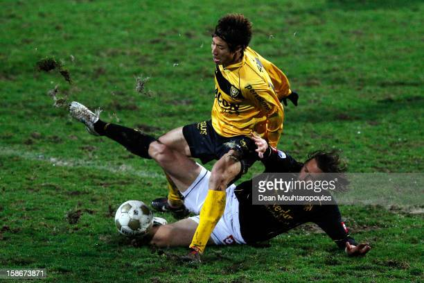 Yuki Otsu of Venlo is tackled by Laurent Delorge of Roda JC during the Eredivisie match between VVV Venlo and Roda JC Kerkrade at the Seacon Stadion...