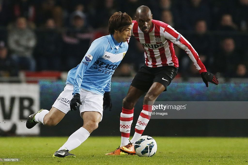 Yuki Otsu of VVV-Venlo (L), Marcelo of PSV (R) during the Dutch Eredivisie match between PSV Eindhoven and VVV-Venlo at the Philips Stadium on march 2, 2013 in Eindhoven, The Netherlands