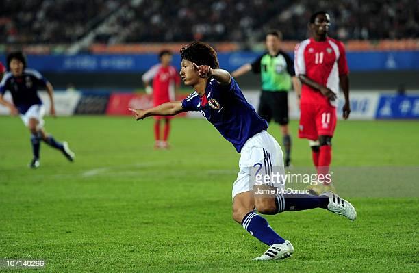 Yuki Saneto of Japan celebrates scoring the opening goal in the Men's Final between United Arab Emirates and Japan at Tianhe Stadium during day...