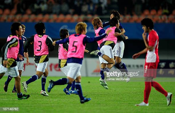 Yuki Saneto of Japan celebrates with team mates at the final whistle after winning gold in the Men's Final between United Arab Emirates and Japan at...