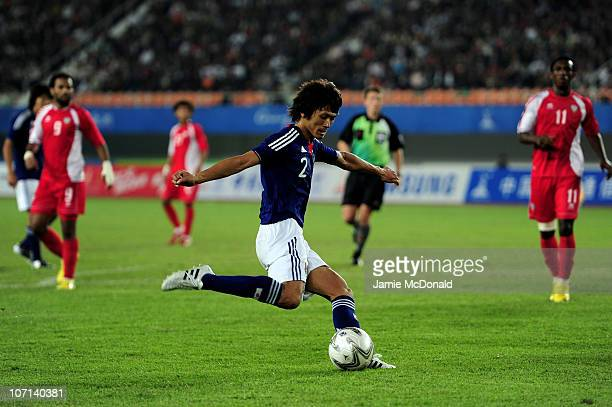 Yuki Saneto of Japan scores the opening goal in the Men's Final between United Arab Emirates and Japan at Tianhe Stadium during day thirteen of the...