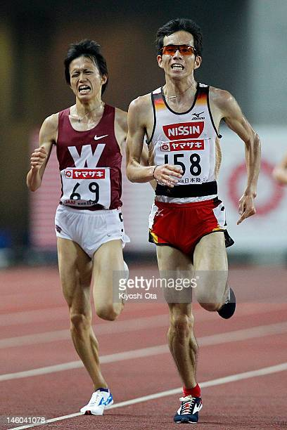 Yuki Sato of Japan competes with Suguru Osako in the Men's 10000m final during day two of the 96th Japan National Championships at Nagai Stadium on...