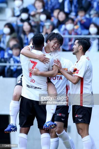 Yuki Soma of Nagoya Grampus celebrates with team mates after scoring his side's third and winning goal during the JLeague J1 match between Gamba...