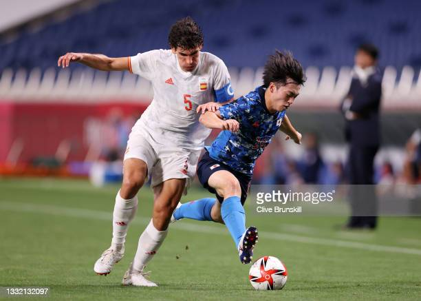 Yuki Soma of Team Japan is challenged by Jesus Vallejo of Team Spain during the Men's Football Semi-final match between Japan and Spain on day eleven...