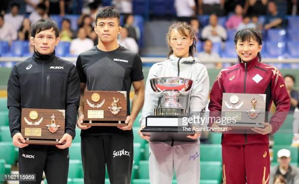 Yuki Takahashi Kenichiro Fumita Risako Kawai and Yui Suzaki pose for photographs during the award ceremony on day four of the All Japan Wrestling...